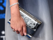 Jaimie Alexander added some sparkle with a small silver clutch.