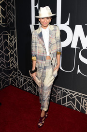 Zendaya Coleman added a feminine touch with a pair of strappy purple platform sandals by Ruthie Davis.