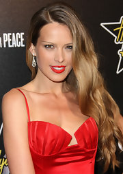 Petra Nemcova wore her long tresses in soft side-swept waves at the 5th annual Hollywood Domino Gala.