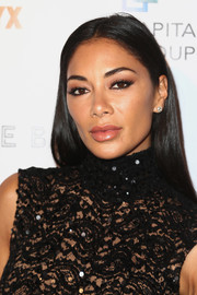 Nicole Scherzinger kept it simple with this straight center-parted hairstyle at the Imagine Ball.