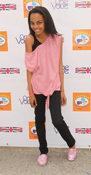 China Anne McClain went pink and black in an off-shoulder tunic at the Annual Kidstock Music and Arts Festival.
