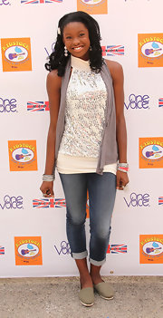 Coco Jones opted for a casual look with faded folded jeans and a dressy top at the Kidstock Music and Arts festival.