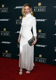 January Jones coordinated her dress with a pair of strappy silver sandals.