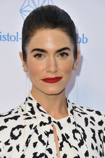 Nikki Reed styled her hair into a brushed-back bun for the 2019 Sports Humanitarian Awards.