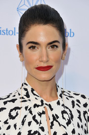 Nikki Reed finished off her look with an elegant red lip.
