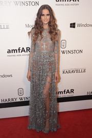 Izabel Goulart looked absolutely dreamy in a sheer, beaded gray gown by Valentino at the amfAR Inspiration Gala Sao Paulo.