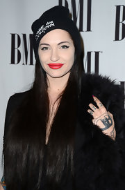 Porcelain Black applied a riotous red lipstick to complete her look.