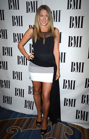 Colbie Caillat got adventurous with her wardrobe choices at the BMI Pop Awards in this black and gray fishtail dress.