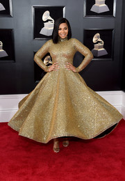 Ashanti was a stunner in a micro-beaded gold Yas Couture by Elie Madi gown at the 2018 Grammys.