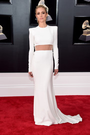 Kristin Cavallari kept it minimal yet sophisticated in a long-sleeve white Alex Perry gown with a peekaboo waist at the 2018 Grammys.