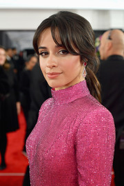 Camila Cabello wore a pair of Harry Winston gemstone drop earrings in two shades of pink to the 2019 Grammy Awards.