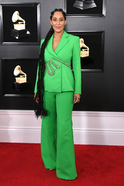 Tracee Ellis Ross opted for a snake-embellished green pantsuit by Ralph & Russo Couture when she attended the 2019 Grammys.