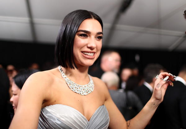 Dua Lipa complemented her strapless silver gown with a diamond collar necklace.