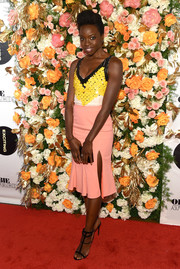 Danai Gurira teamed her top with a high-slit, ruffle-hem skirt, also by Altuzarra.