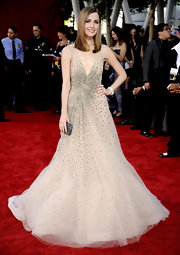 Rose's glitzy clutch looks amazing with her stunning Valentino gown.