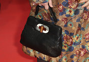 Isabella Rossellini paired her unique coat with a handsome vintage-inspired handbag.