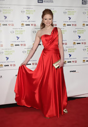 Barbara Meier wowed the crowd in a brilliant red one-shoulder dress at the Cinema For Peace Gala.