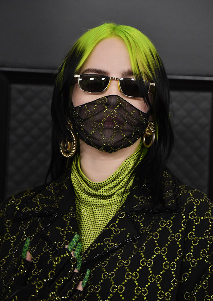 Billie Eilish sported a pair of mismatched gold hoops at the 2020 Grammys.