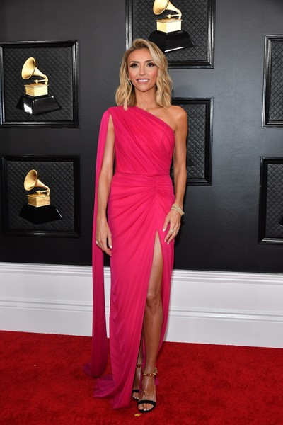Giuliana Rancic chose a fuchsia one-shoulder gown by Rhea Costa for her 2020 Grammys look.