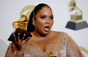 Lizzo posed at the Grammys press room wearing her hair in a tight ponytail.