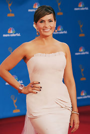 Mariska paired her decadent diamond bracelet with an 18-karat gold Cabochon ruby and diamond bombe ring.