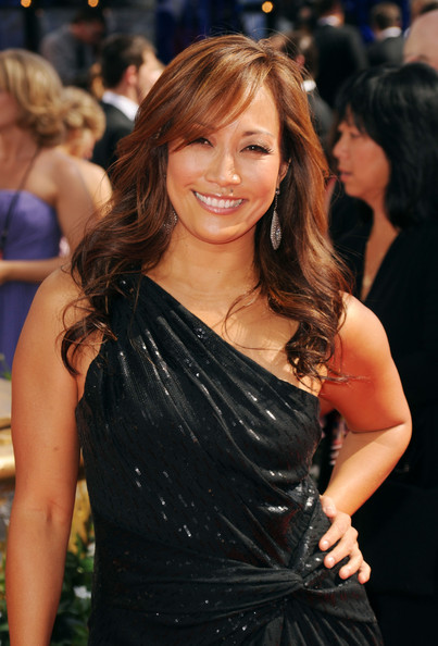 Carrie Anne showed off her radiant brunette locks while walking the red carpet at the Emmy Awards.