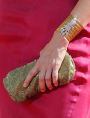 Julia paired her mesh clutch with a matching bracelet with a diamond peacock embellishment.