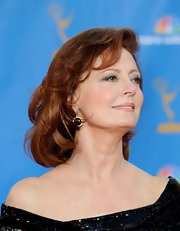 Susan Sarandon walked the 62nd Annual Primetime Emmy Awards red carpet wearing  18-karat gold, onyx and diamond Rock Candy Lollipop earrings.