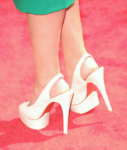 Lauren Bosworth showed off her white platform heels which she paired with a kelly green dress.