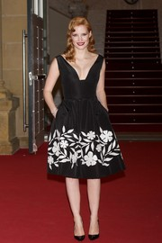 Jessica Chastain enchanted in an Oscar de la Renta cocktail dress with a plunging neckline and a floral-embroidered skirt during the premiere of 'The Disappearance of Eleanor Rigby.'