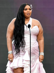 Lizzo went for major glamour with multiple Bulgari Serpenti bracelets at the 2021 Grammy Awards.