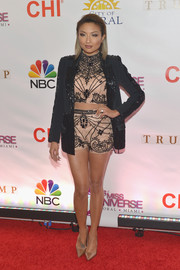 Jeannie Mai topped off her funky-glam outfit with a sequined black jacket.