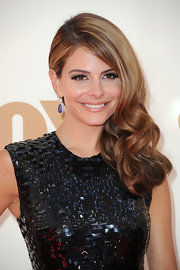 Maria Menounos wore a hint of shimmering metallic champagne shadow to highlight her eyes at the 63rd Annual Primetime Emmy Awards.