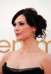 Michelle Forbes wore a causal, messy updo to the 63rd Emmys that still maintained an elegant look. To duplicate her do', pull back tresses into a ponytail and then twist and pins strands at random, spritzing with a medium-hold hairspray to finish.