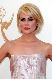 Sultry was the word to describe Rachel Taylor's look at the 63rd Emmys. Her eyes were heavily lined with a black pencil and a palette of gray, burgundy and shimmery pink were applied to create her dramatic style.
