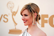 Cara Buono wore a cool, twisted updo to the 63rd Emmys. Her hair was backcombed, a few face-framing strands were sectioned out and the rest of her tresses were pulled back into a low ponytail. Pieces from the ponytail were then sectioned out, twisted and pinned.