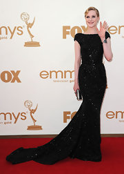 Evan Rachel Wood shined on the red carpet in a black gown. The head-to-toe beaded frock and elegant train was the right touch of drama for the Emmys red-carpet.