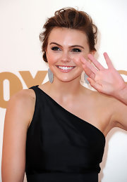 Aimee Teegarden kept it simple with a black gown and elegant updo then added a pair of bold, 14k white gold earrings with carved white jade and diamonds.