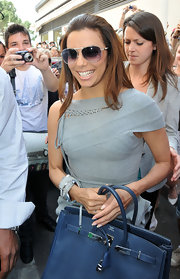 Eva topped off her look with a pair of classic silver aviator-style shades with gradient lenses.