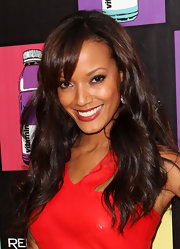 Selita Ebanks styled her brunette mane in polished curls and side parted bangs at the Cannes Film Festival.
