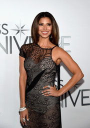 Roselyn Sanchez wore a duo of diamond bracelets and some rings for a bit of sparkle to her black gown at the Miss Universe Pageant.