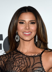 Roselyn Sanchez looked a bit retro wearing this high-volume center-parted 'do at the Miss Universe Pageant.