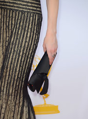 Lily Rabe let her lacy gown do all of the talking with this low-key black tassle-adorned satin clutch.