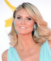 Heidi Klum shimmered in these sparkly turqoise-hued gemstone earrings.