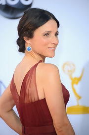 Julia Louis-Dreyfus added a pretty pop of color to her rich red gown with these bright blue dangling earrings.