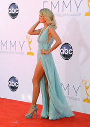 Heidi Klum kept her look completely color-coordinated with these strappy turqoise stilettos.