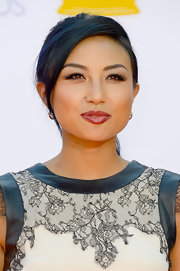 Jeannie Mai topped off her Emmy Awards look with a ponytail and side-swept bangs.