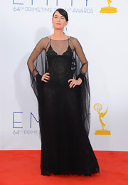 Lena Headey chose a dramatic sheer black lace gown for the Emmy Awards.