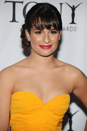 Lea showed off her sexy collarbone with a strapless gown and a twisted updo.