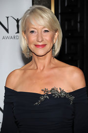 Helen Mirren completed her look with 19th Century diamond fringe earrings in silver on gold.